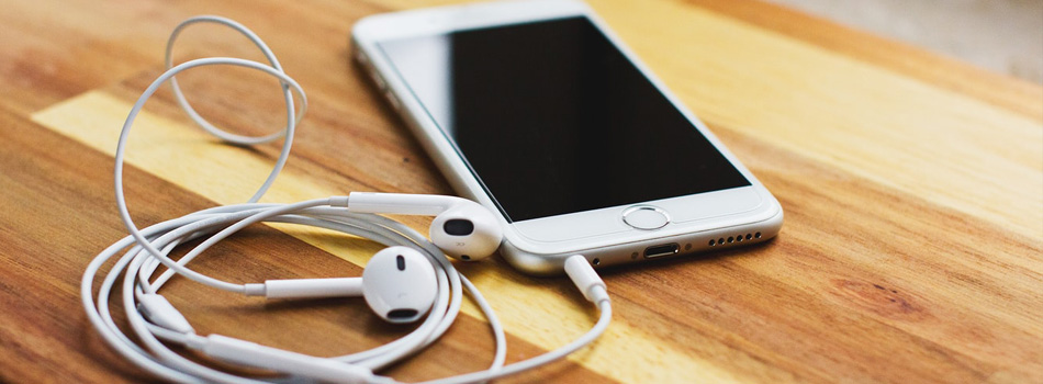 Social Proof podcast image - Apple iPhone and headphone